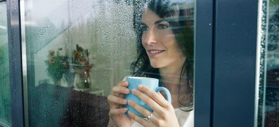 woman laughing window